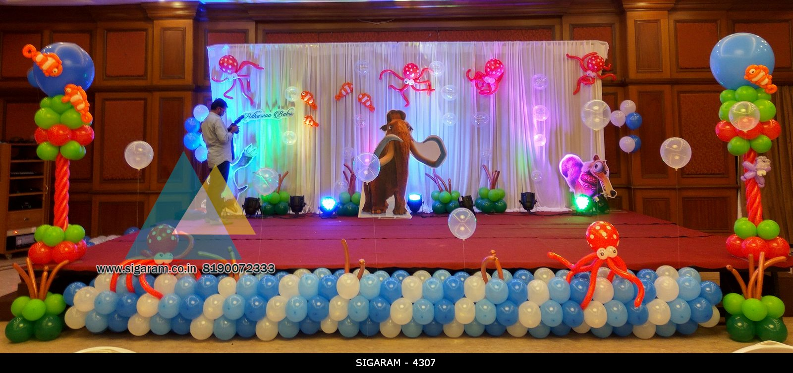 Themed birthday party decoration at hotel shenbaga for 1st birthday hall decoration