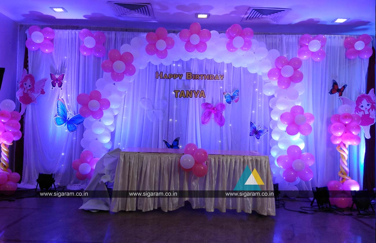 Birthday party balloon decoration hotel green palace for 1st birthday hall decoration