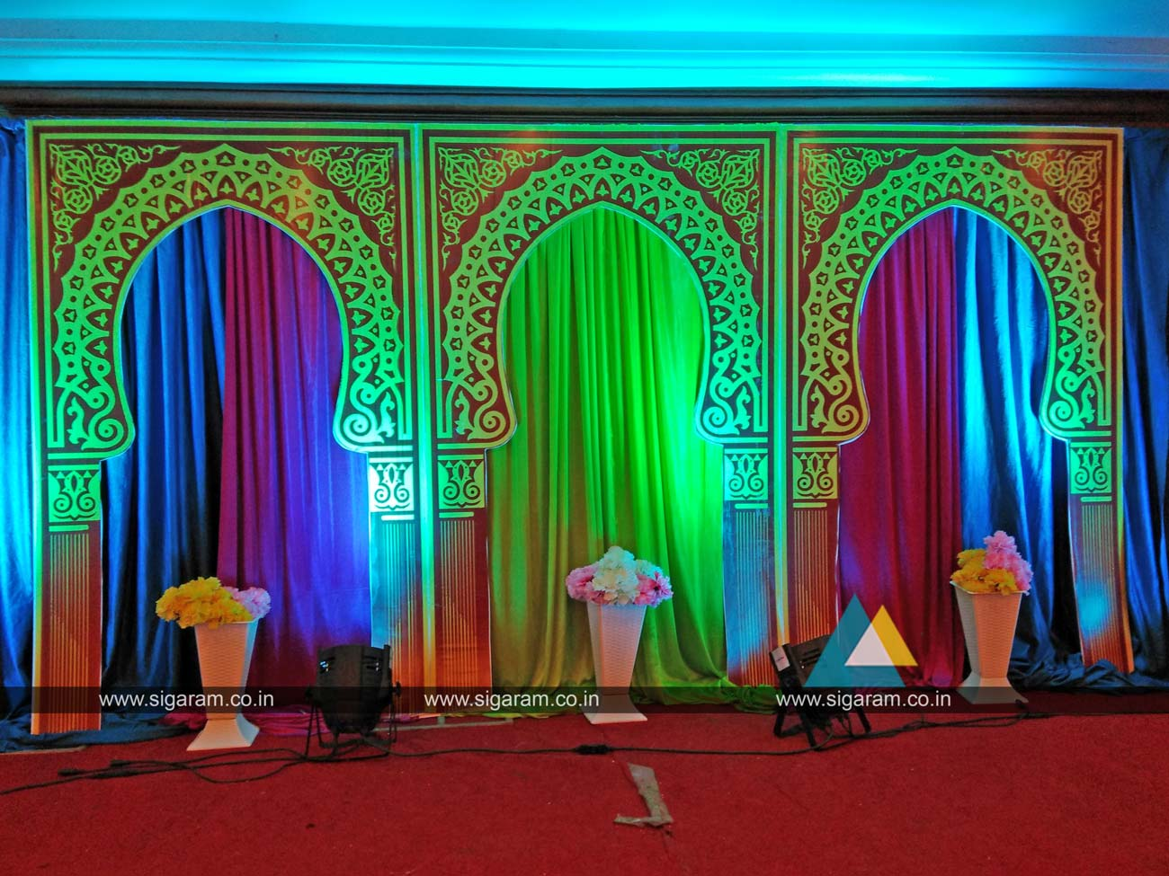 Mehandi stage decoration done at hotel shenbaga convention for Auditorium stage decoration