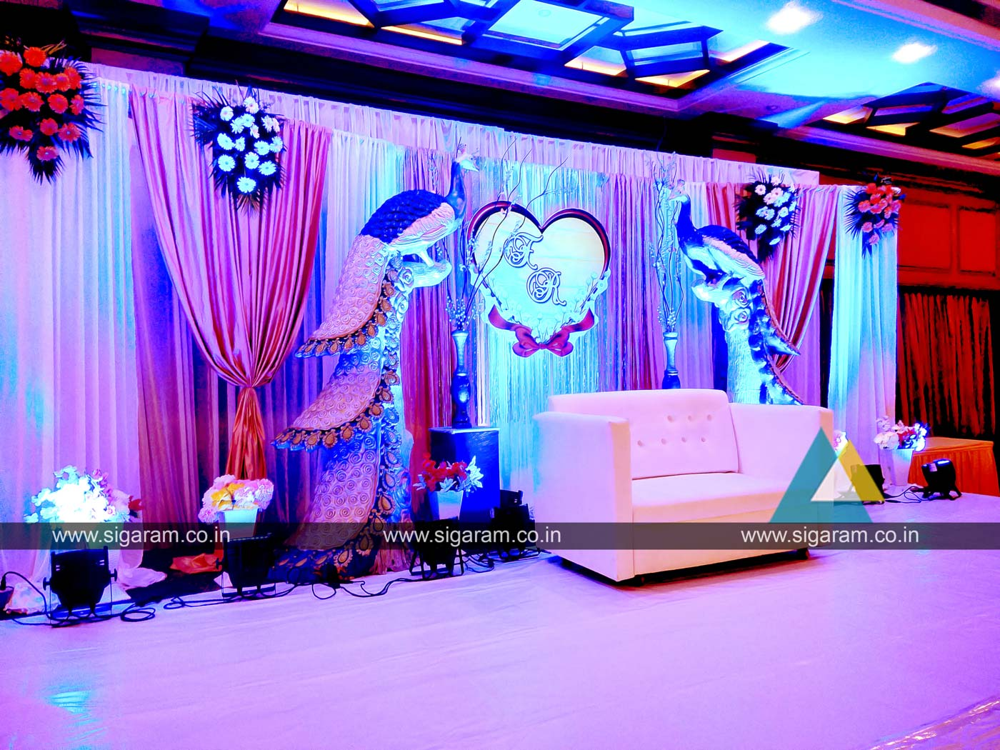 Peacock Themed Engagement Stage Decoration At Hotel Shenbaga